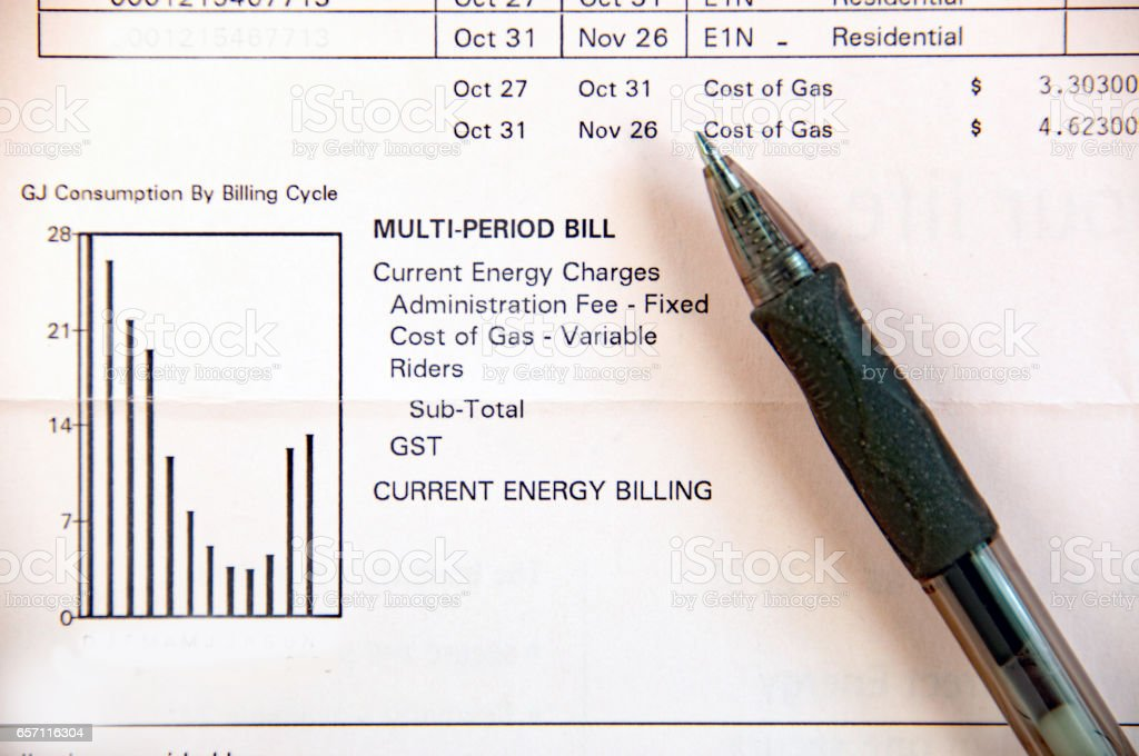 Close-up of home utility natural gas bill with pen stock photo