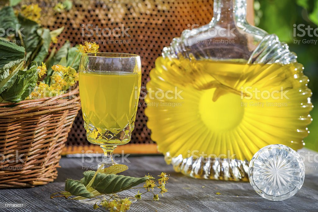 Closeup of homemade liqueur with lime and honey royalty-free stock photo