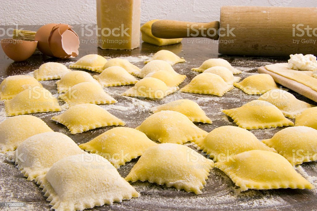 Close-up of homemade ravioli surrounded with ingredients stock photo