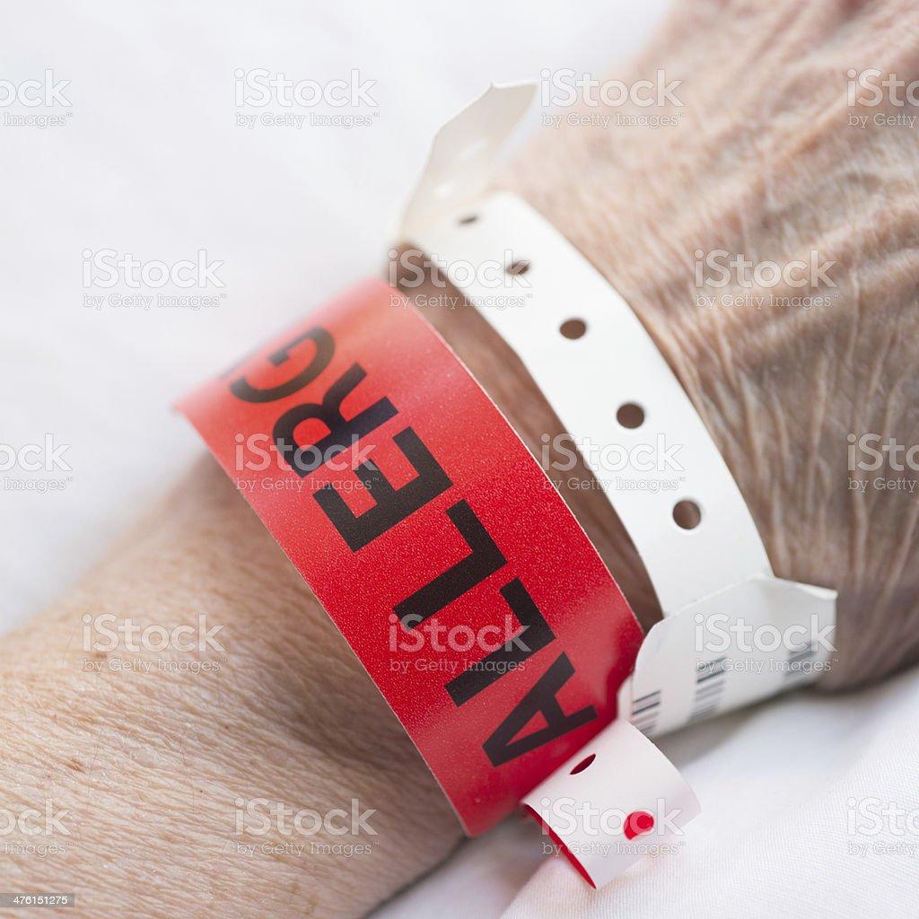 Close-up of Hospital Wrist Allergy Bracelet Warning stock photo