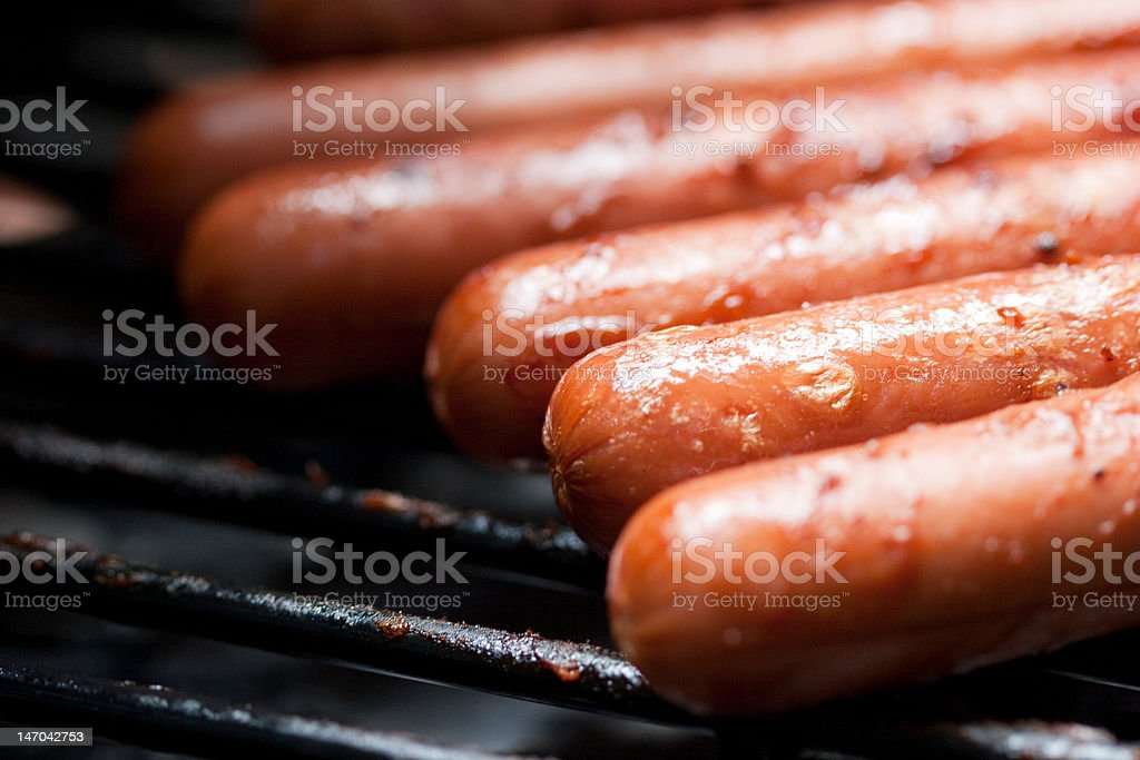 Close-up of Hot Dogs on a Barbecue Grill royalty-free stock photo