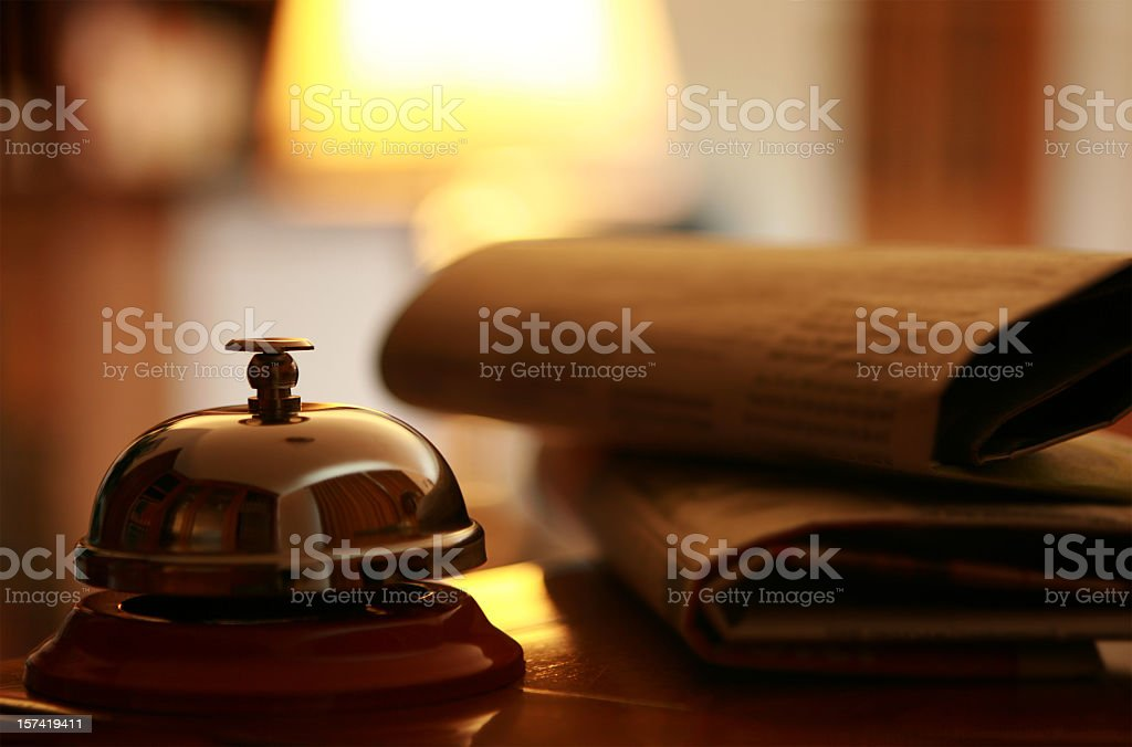 Closeup of hotel bell and newspapers royalty-free stock photo