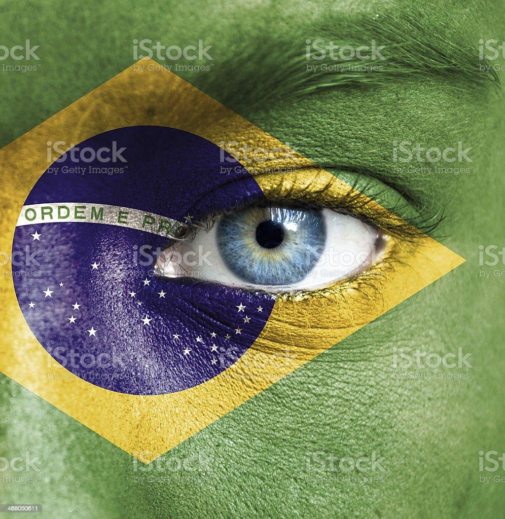 Closeup of human eye painted as the Brazilian flag royalty-free stock photo