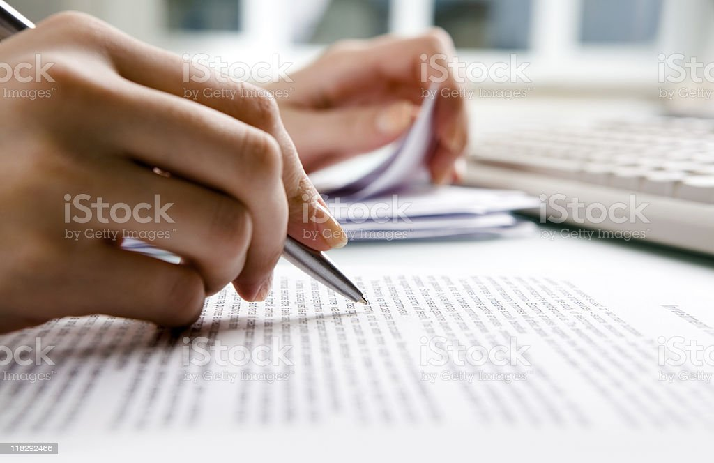Close-up of human hands doing paperwork stock photo
