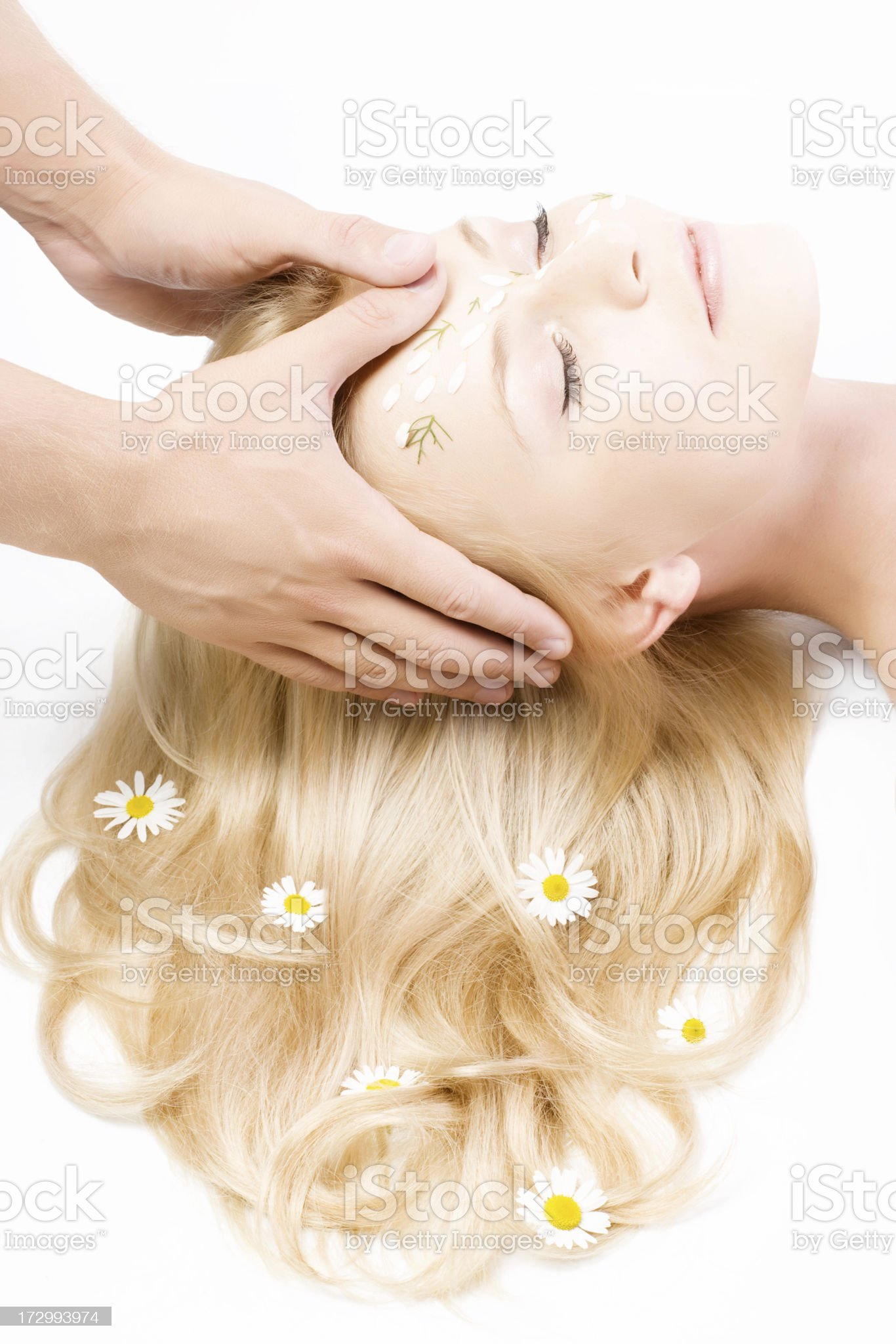 Closeup of human hands massaging a young pretty woman's face royalty-free stock photo