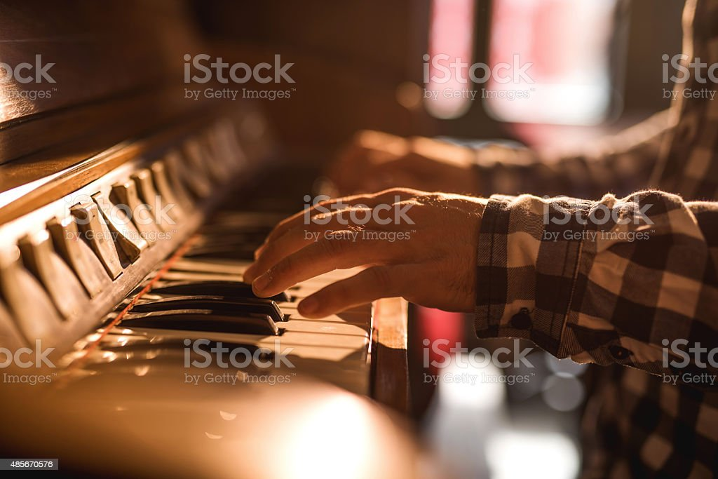 Close-up of human hands playing piano. stock photo