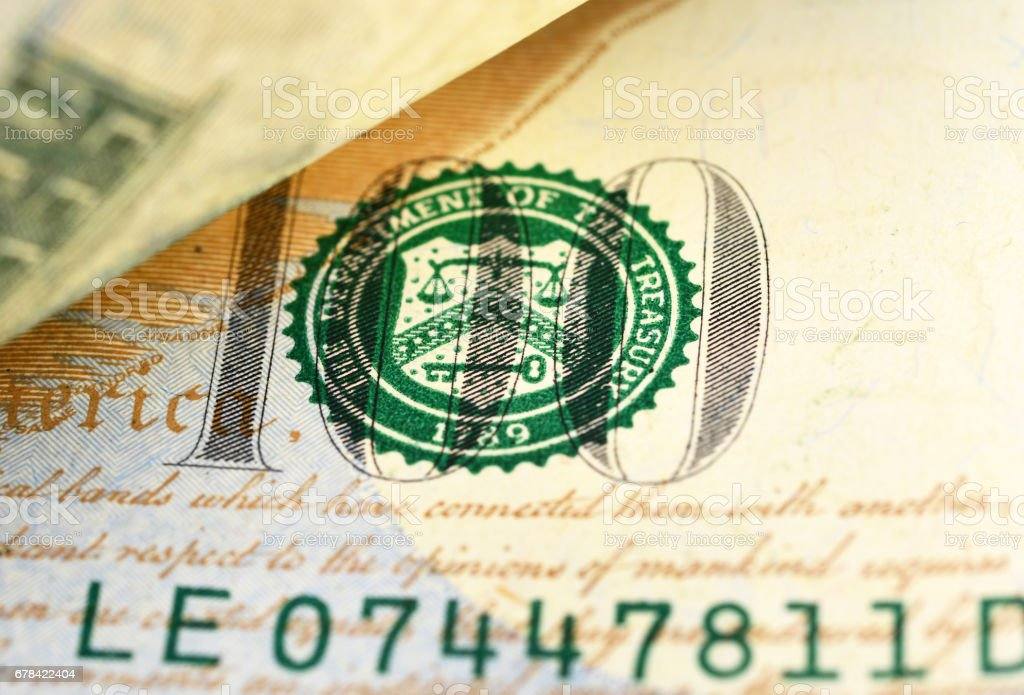 Closeup of Hundred dollars bill stock photo