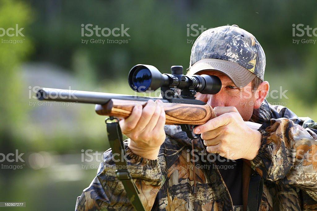Closeup of hunter ready to aim at animal stock photo