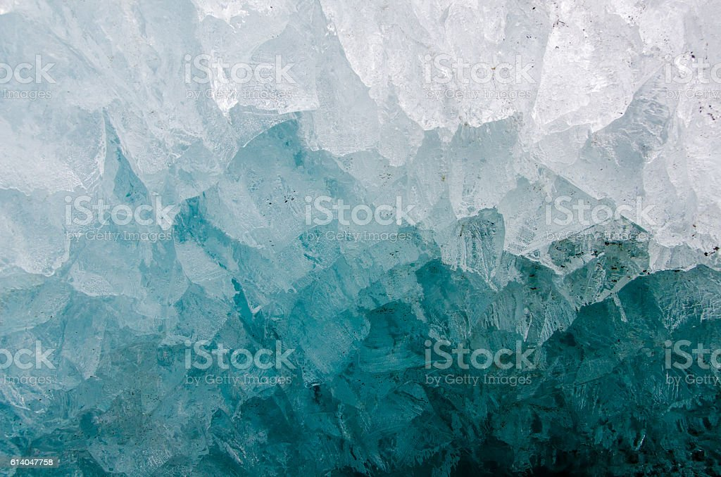 close-up of ice cave on a glacier, with ice crystals. stock photo