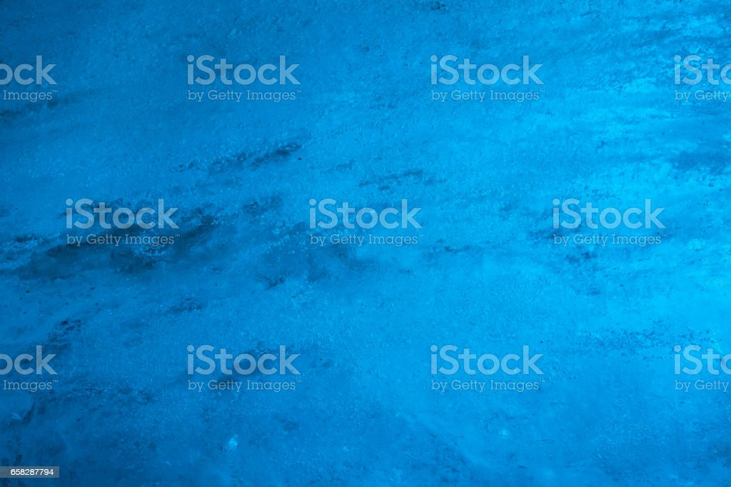 Close-up of ice wall inside glacier tunnel stock photo