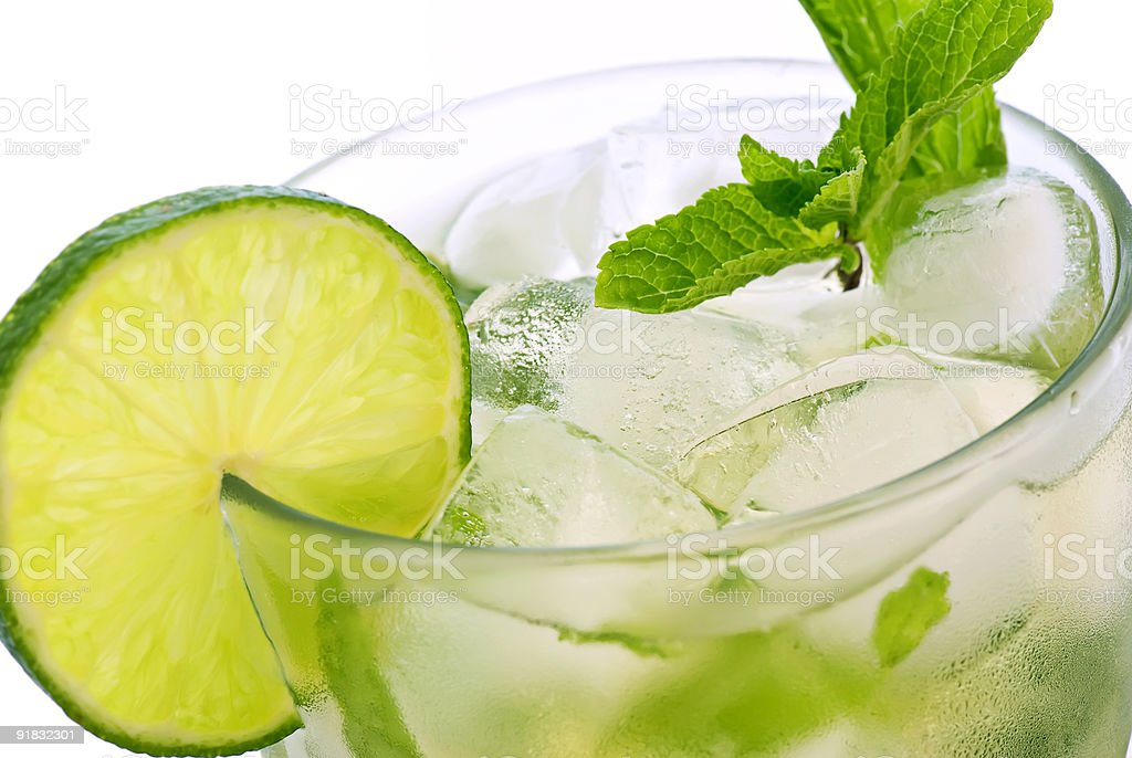 Close-up of iced mojito in glass with lime slice royalty-free stock photo
