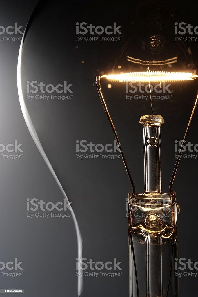 Close-up of illuminated light bulb against gradation background stock photo