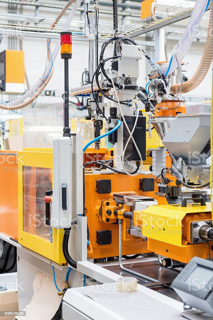 Close-up of injection moulding machine stock photo