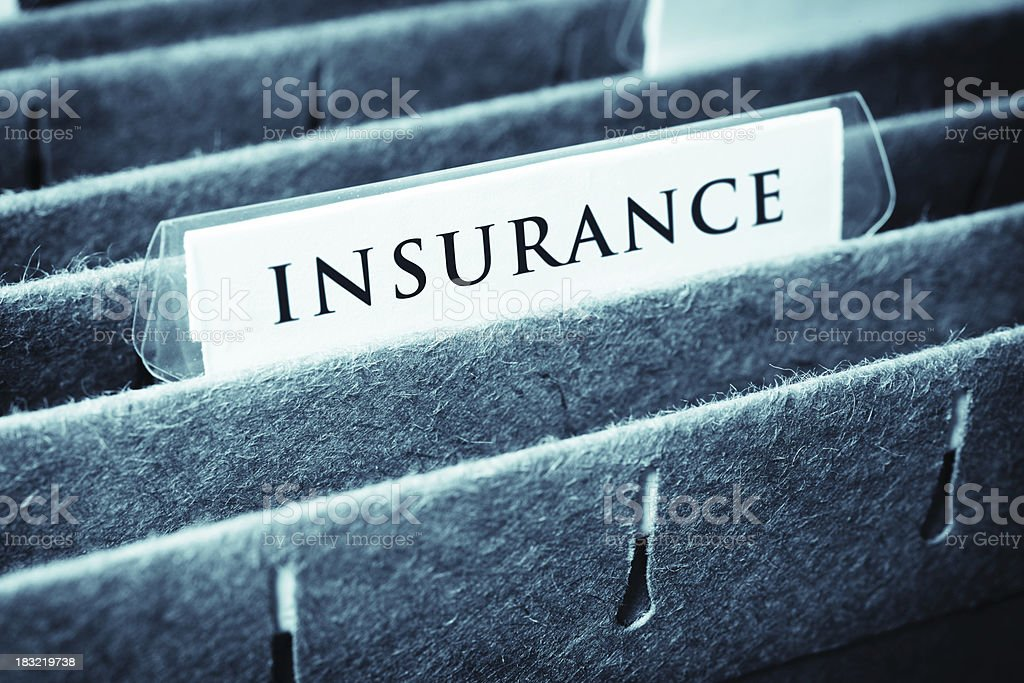Close-up of insurance file stock photo