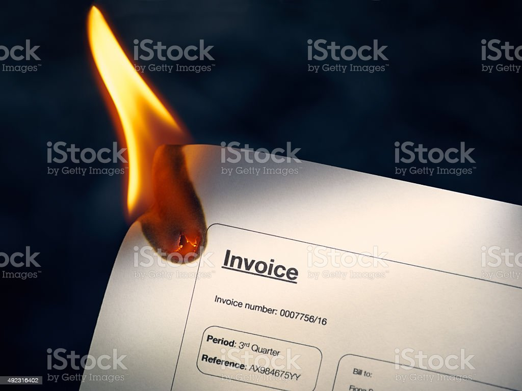 Closeup Of Invoice Paper Burning On Fire stock photo