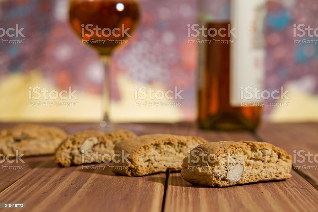 Closeup of Italian cantucci biscuits over a wooden table stock photo