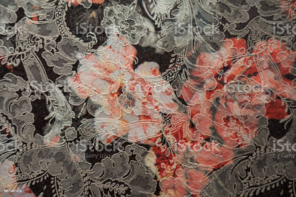 Close-up of jacquard fabric with floral print from above stock photo