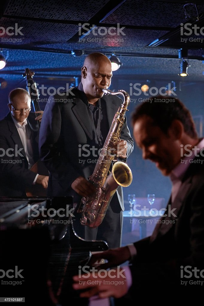 Close-up of jazz musicians and pianist in a club stock photo