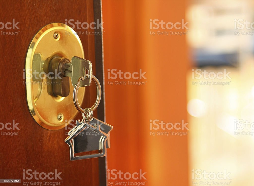 Close-up of key in a door lock stock photo