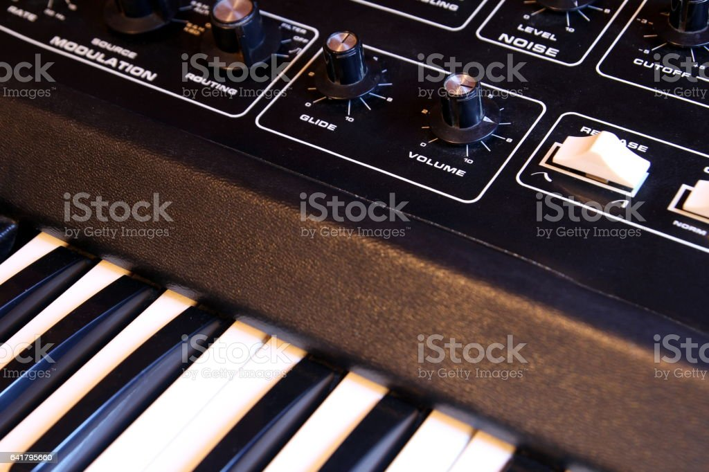 Closeup of keyboard and controls of a retro analogue synthesizer stock photo
