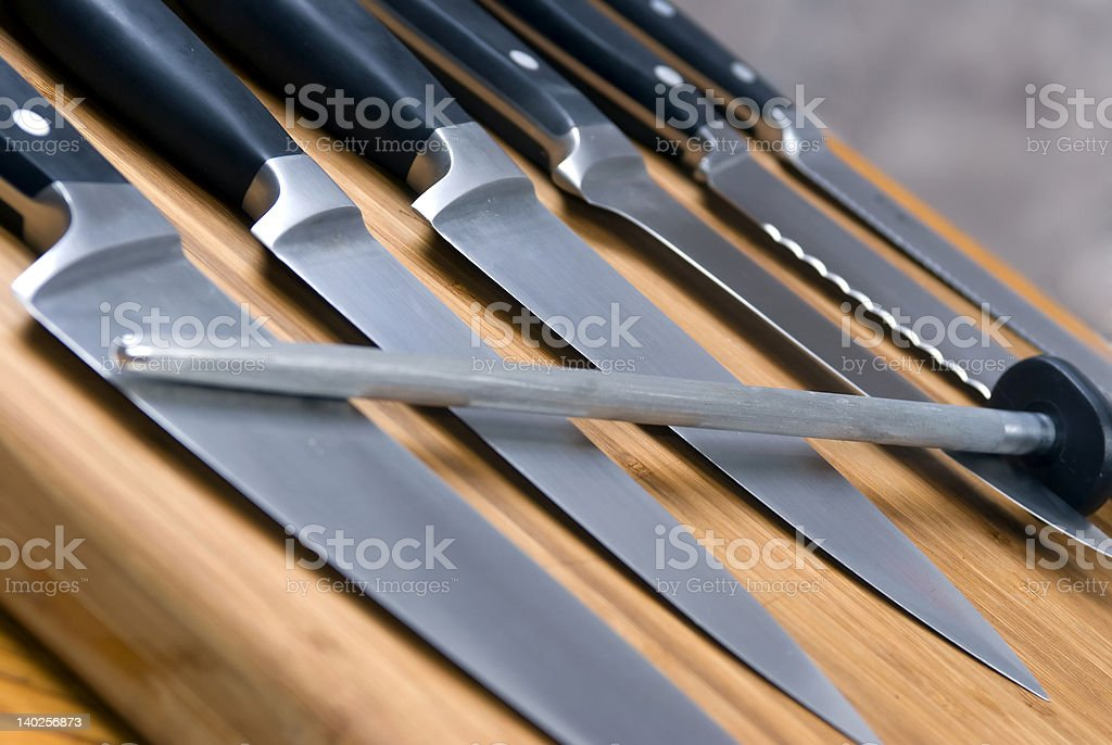 Close-up of kitchen knives on a wooden cutting board stock photo