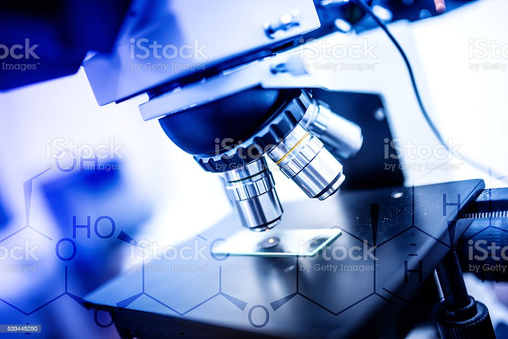 close-up of laboratory microscope, tools and probes stock photo