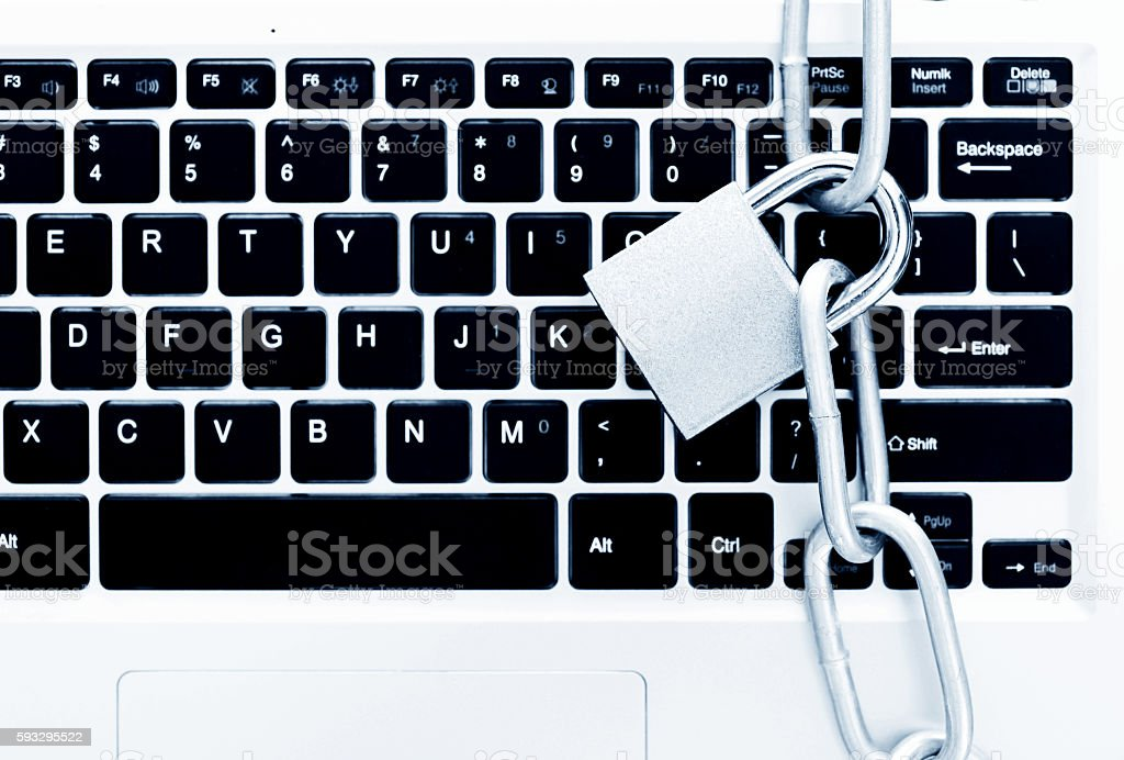Closeup of laptop with chains and padlock stock photo