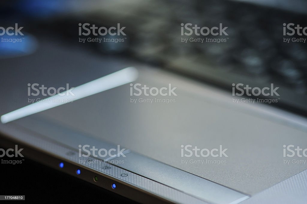 Close-up of laptop's touch pad royalty-free stock photo