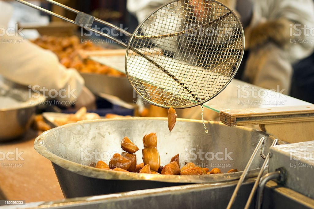 Closeup of lard cake being fried in a professional kitchen. stock photo