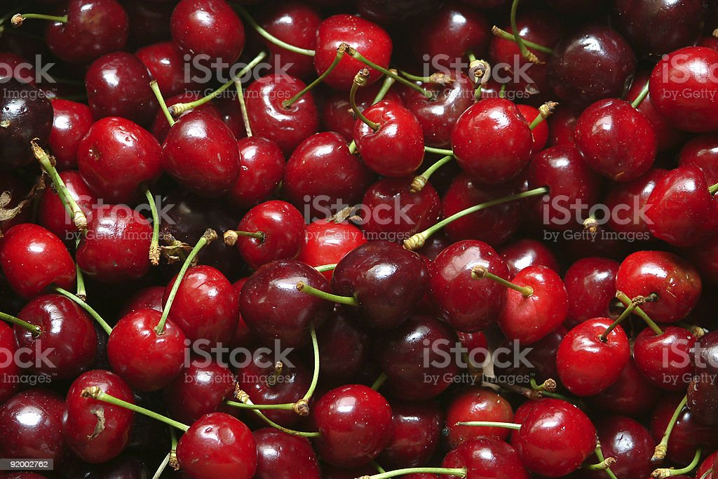 Close-up of large cluster of red cherries stock photo