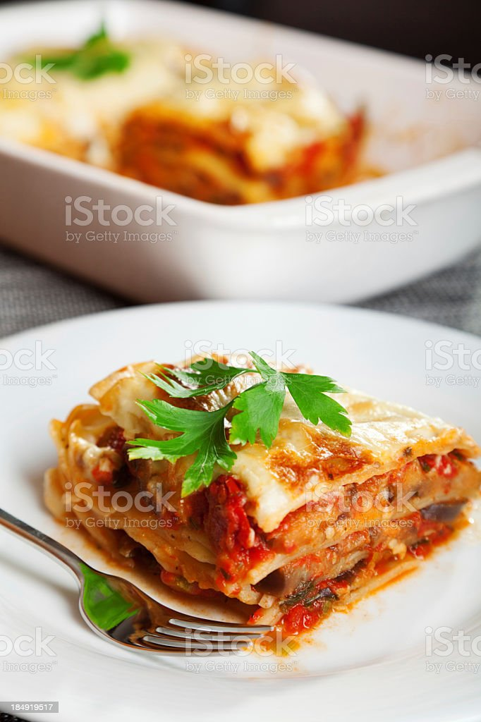 Closeup of lasagna on a white plate  stock photo