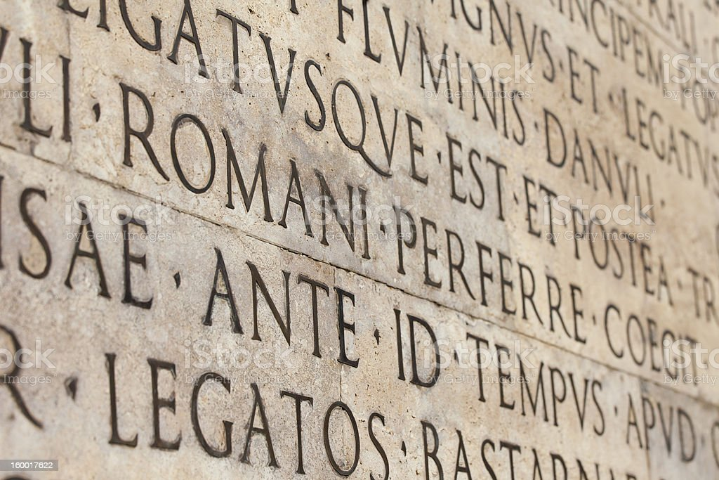 Close-up of latin words carved on white marble monument wall royalty-free stock photo
