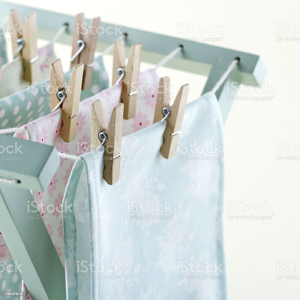Closeup of laundry on wooden drying rack stock photo
