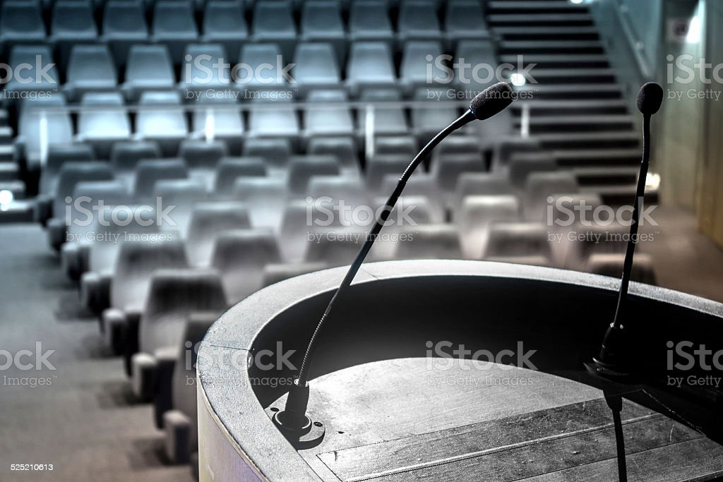 Close-up of lectern in empty conference hall stock photo