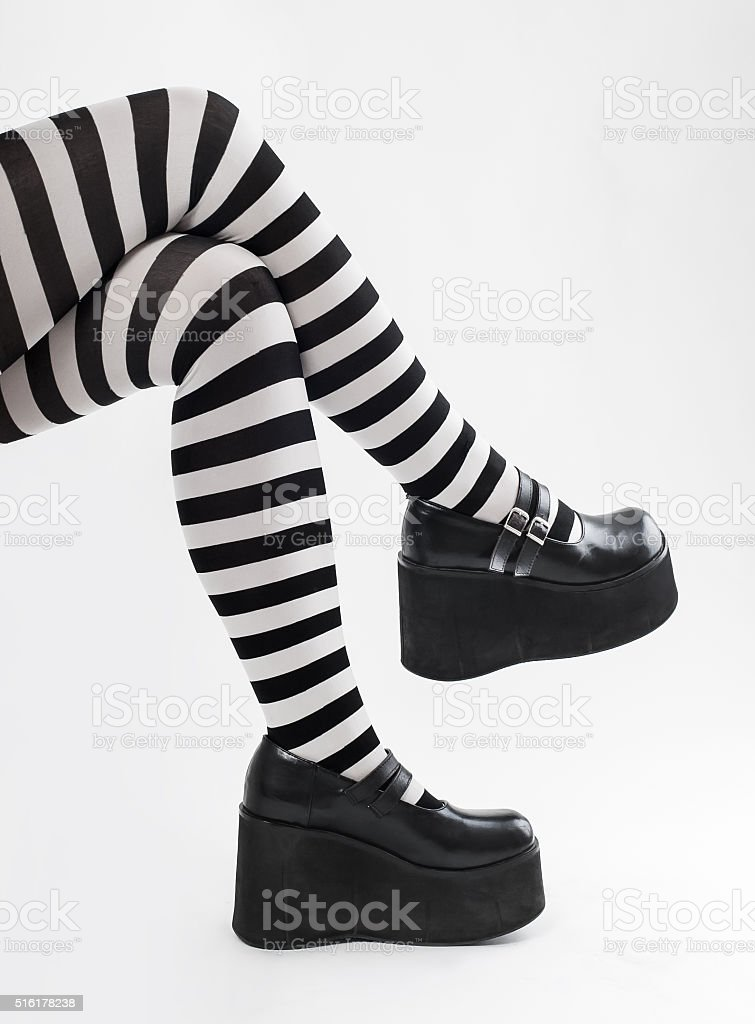 Closeup of legs of a woman stock photo