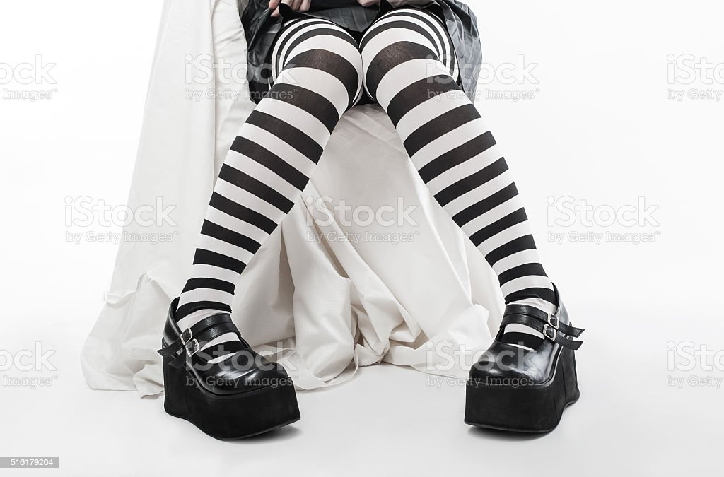 Closeup of legs of a woman stock photo