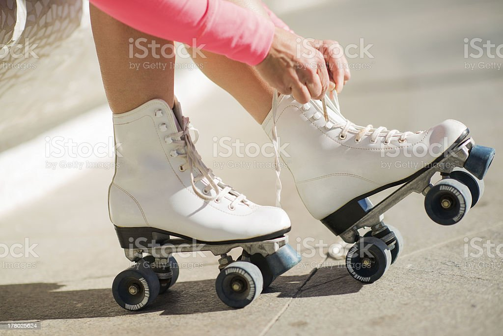 Close-up Of Legs With Roller Skating Shoe stock photo