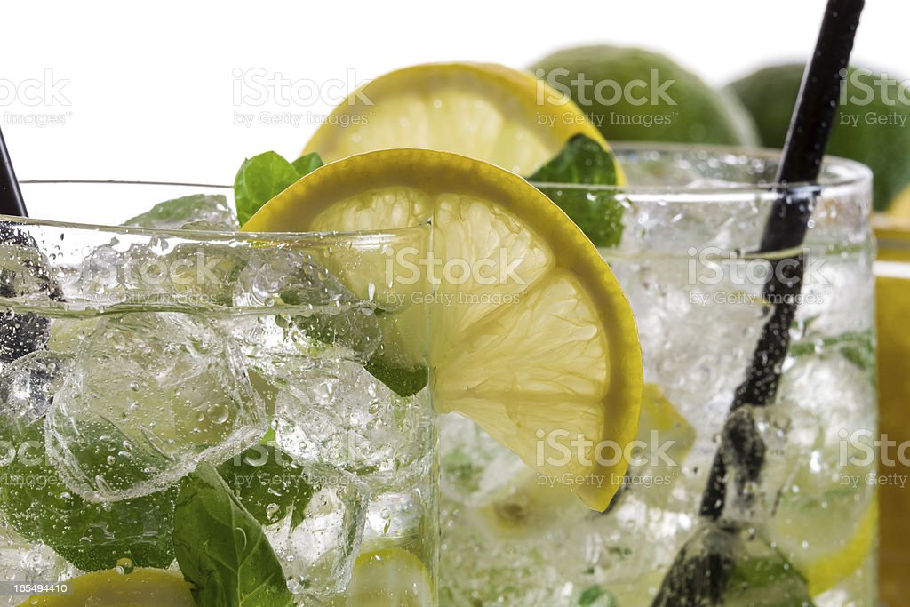 Closeup of lemon drink with ice in glass stock photo
