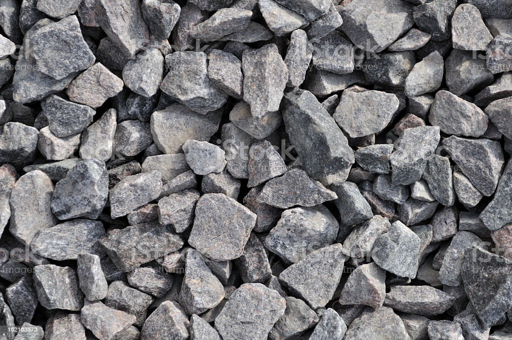 Close-up of light gray gravel used as a background stock photo
