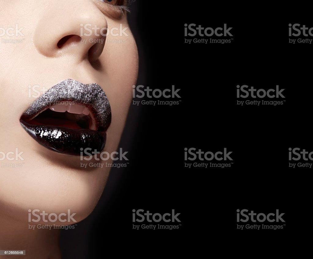 Closeup of lips. Black andd Silver lipstick. Cosmetic makeup image. stock photo