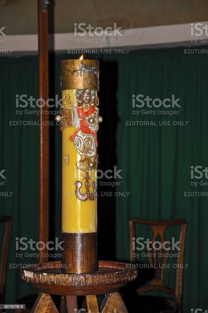 Close-up of lit candle with image of Jesus Christ in the Santuário das Almas church. stock photo
