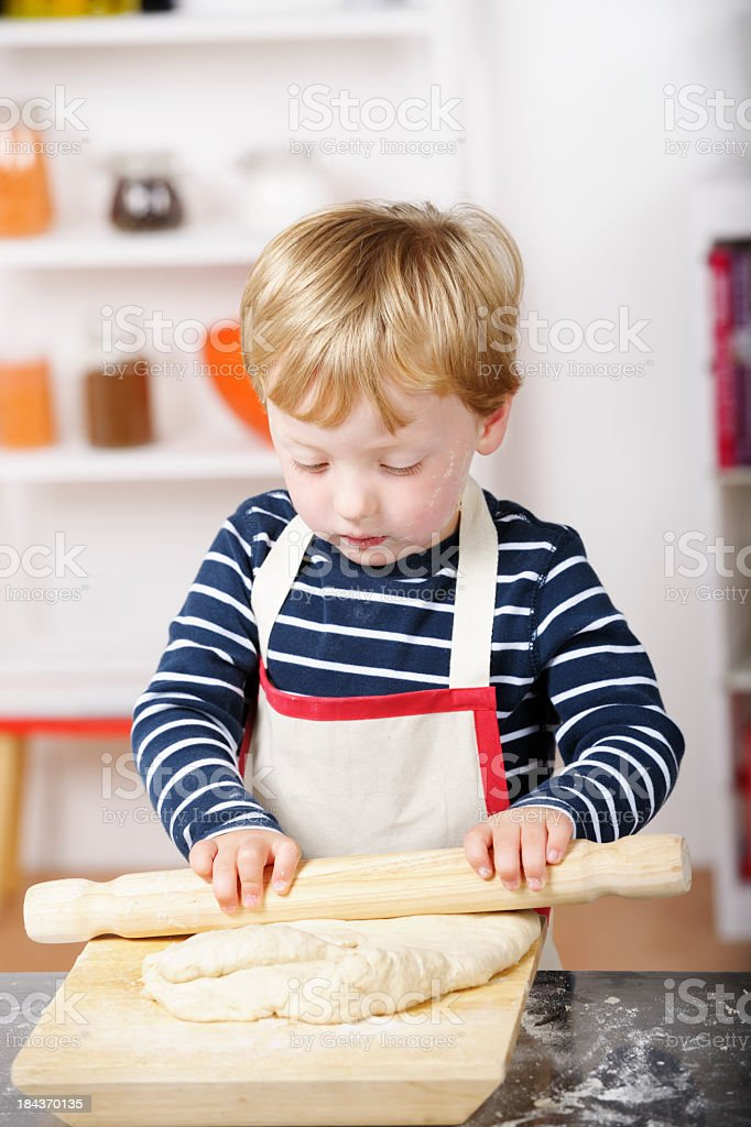 Close-Up Of Little Boy Rolling Dough royalty-free stock photo