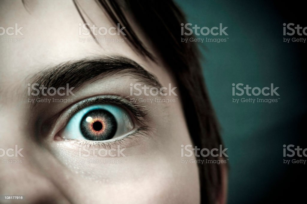 Close-up of Little Boy's Eye with Red Pupil stock photo