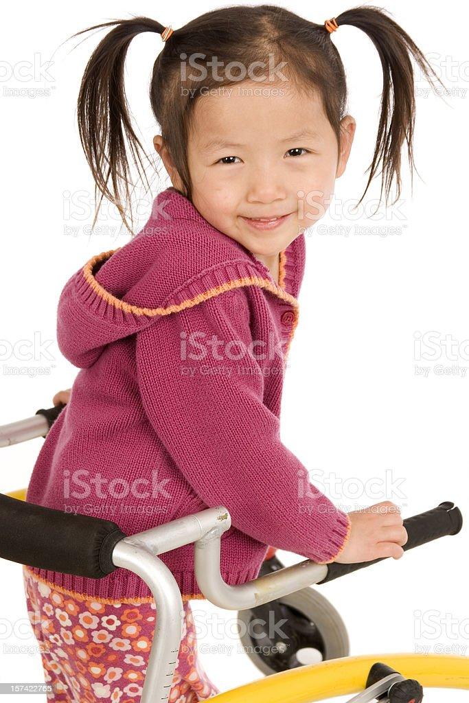 Closeup of little girl using walker royalty-free stock photo