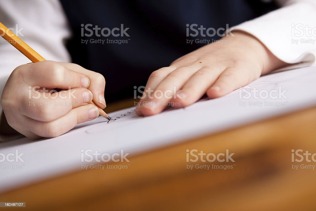 Closeup of Little Student Girl's Hands Writing or Drawing royalty-free stock photo
