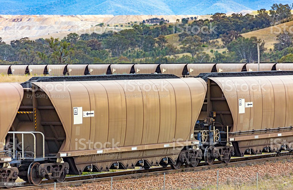Close-up of loaded coal train on tight curve departing mine stock photo