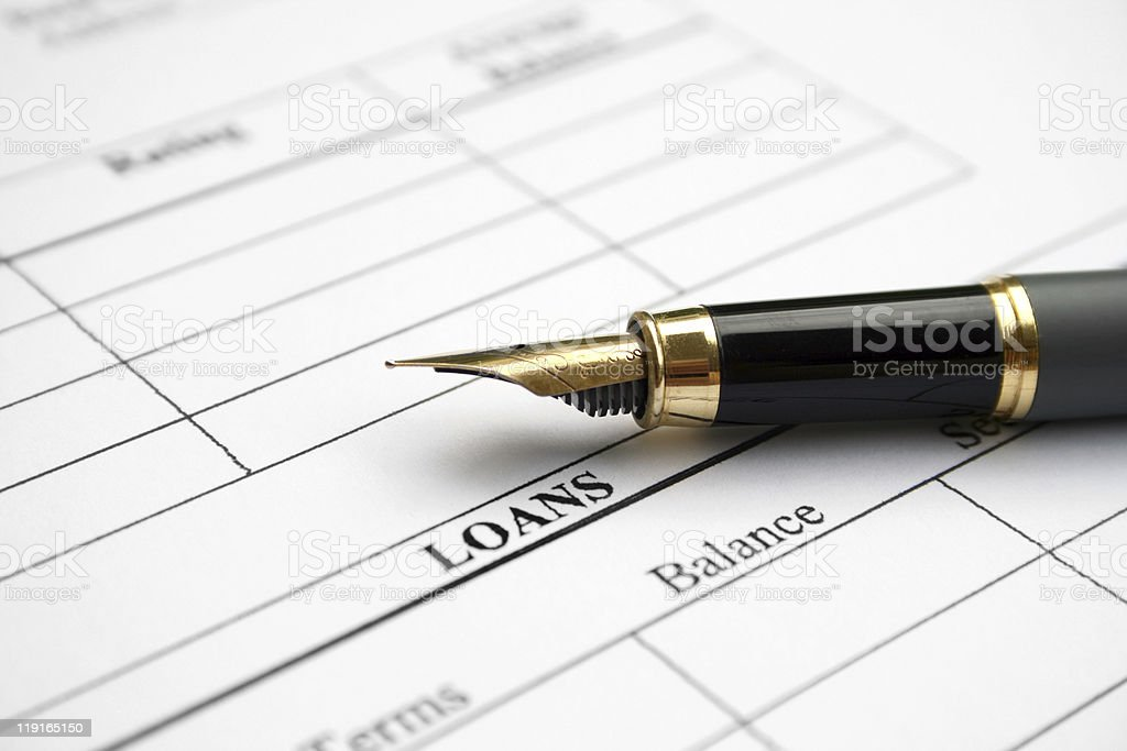 Close-up of loan application form and fountain pen stock photo