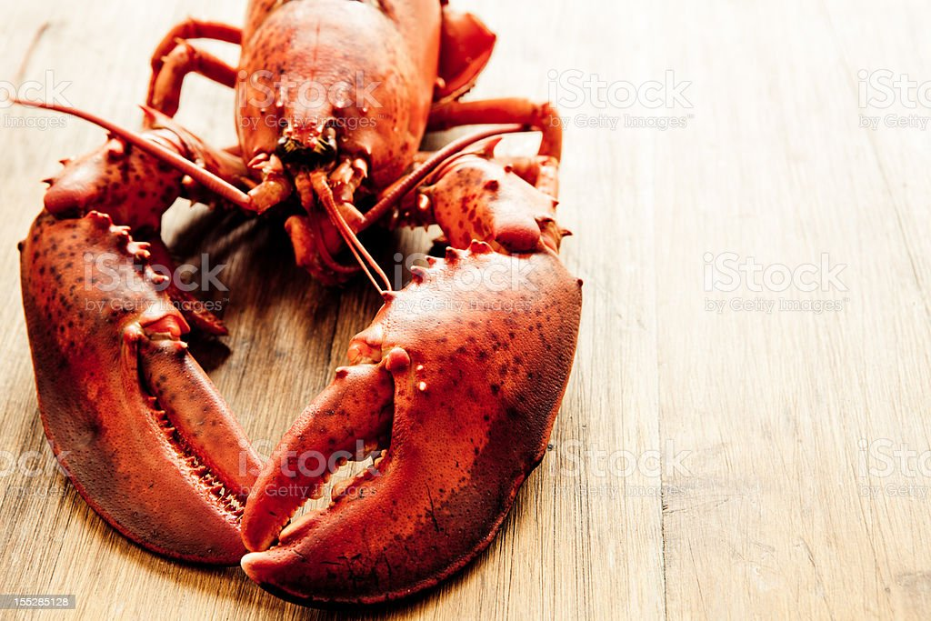 Close-up of lobster on wooden table stock photo