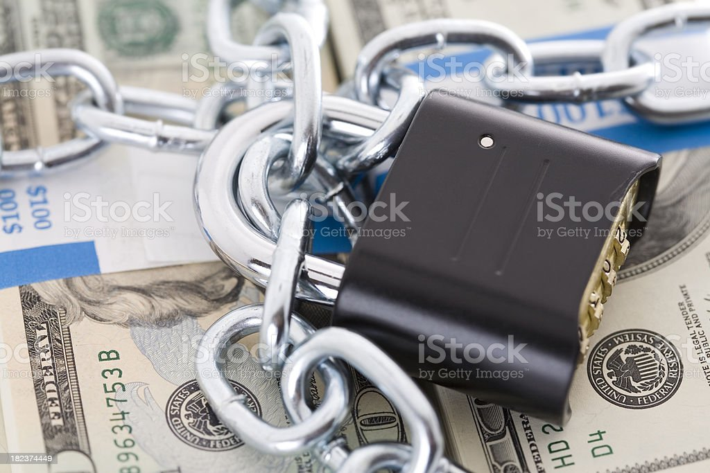 Closeup of Lock and Chains Locking Up Cash royalty-free stock photo