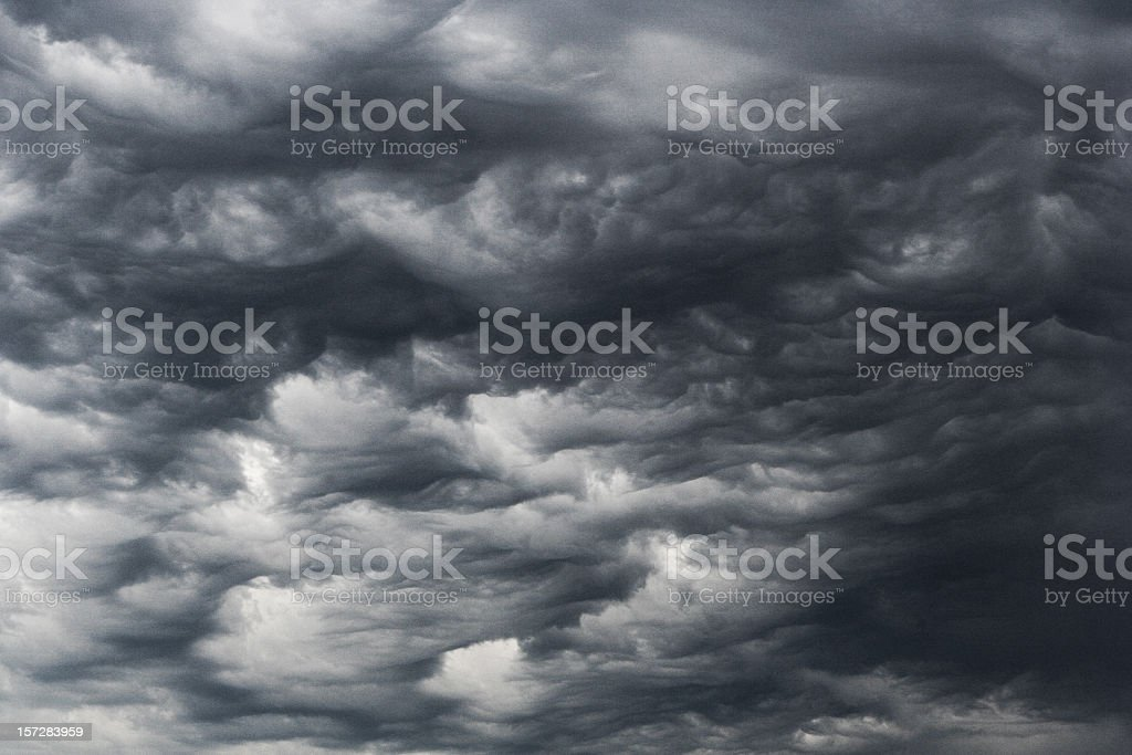 Close-up of looming dark storm clouds blanketing the sky royalty-free stock photo
